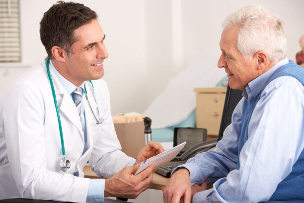 elderly man talking to a doctor